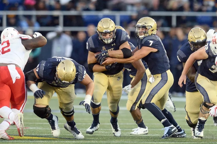Navy fullback Anthony Gargiulo takes a handoff earlier this season against Houston. Gargiulo said a victory Saturday over Army at Lincoln Financial Field would send he and his fellow seniors out on a good note.