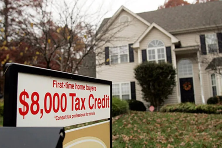 A sign offering a government tax credit for first-time buyers stood outside a home last year in Raleigh, N.C. (Jim Bounds / Bloomberg News)