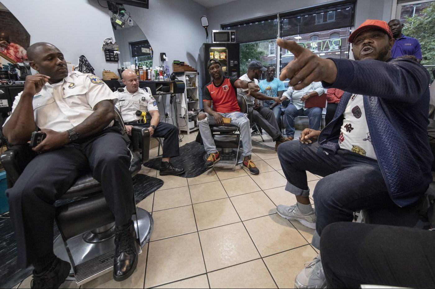 Cops and community members have found a new place to engage: The barbershop