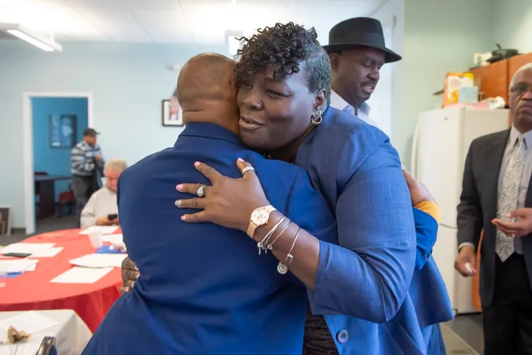Roni Green embraces 44th Ward Leader Willie Jordan after being nominated to run in the February 25th special election for the 190th District of the state house in West Philadelphia. (Jonathan Wilson / For the Inquirer)