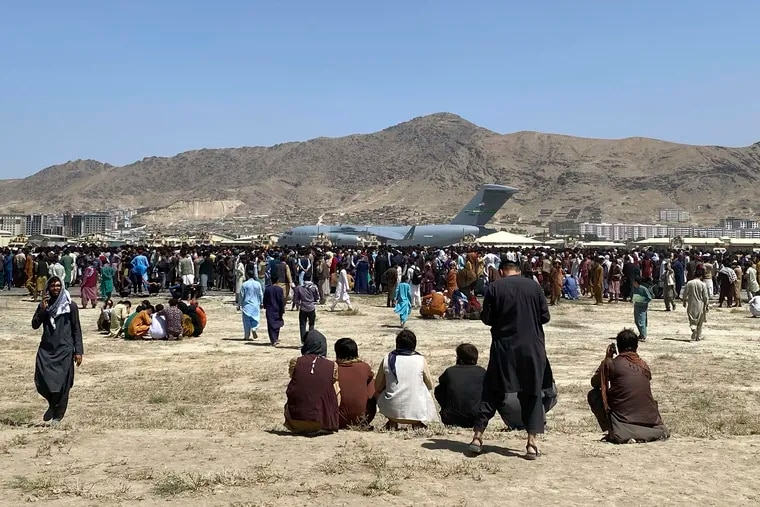 Hundreds of people ran alongside a U.S. Air Force C-17 transport plane as it moved down a runway of the international airport in Kabul on Monday.