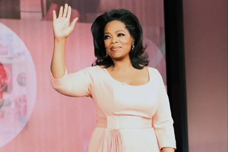 Oprah Winfrey waves as her show taped for the last time Tuesday in Chicago. Her final show aired Wednesday. (AP Photo/Harpo Productions, George Burns)