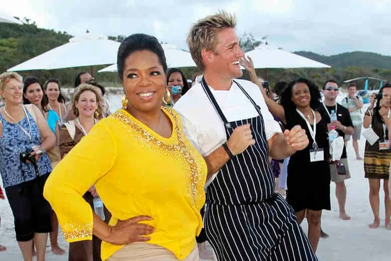 Oprah Winfrey and Australian celebrity chef Curtis Stone show some moves during O's visit down under.