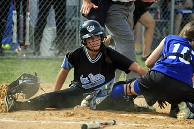 Toms River's Alyssa Paul is safe at home during the second inning as Williamstown catcher Chrissy Tamburrino is unable to make the tag. (Akira Suwa / Staff Photographer)