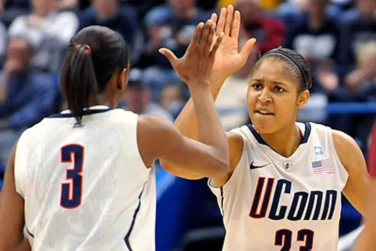 Maya Moore (right) scored a career high 41 points in Connecticut's record-breaking 89th straight win. (Jessica Hill/AP)