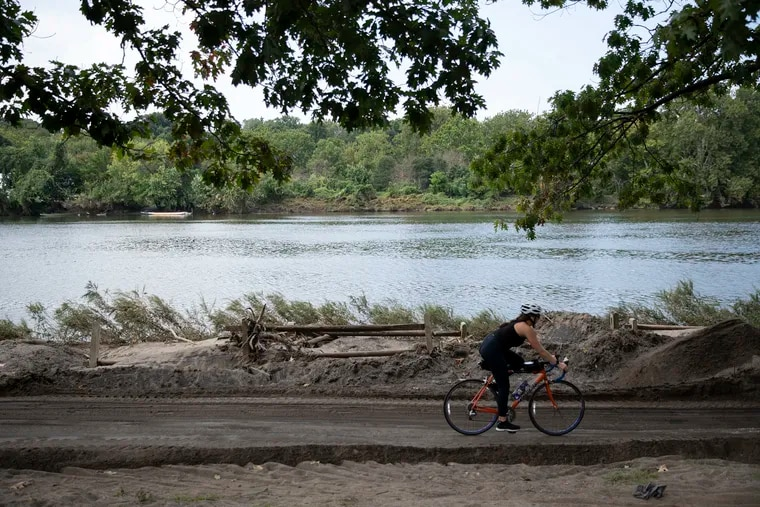 Piles of sand and debris surround the Schuylkill River Trail near the Columbia Train Bridge earlier this month, the result of Ida-related remnant rains. Ida was one of three major hurricanes this season, with winds of at least 111 mph. Sam might become the fourth.
