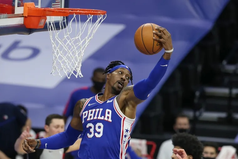 Dwight Howard of the SIxers pulls down a rebound against the Heat during the 1st half of a NBA game at the Wells Fargo Center on Jan. 12, 2021.