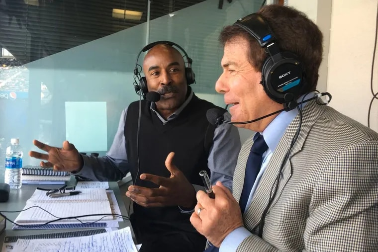 """Longtime Eagles announcer Merrill Reese (right), seen here seated beside his broadcast partner Mike Quick, wasn't too thrilled about the conditions at the Los Angeles Memorial Coliseum during the Eagles 30-23 win over the Rams on """"Sunday Night Football."""""""