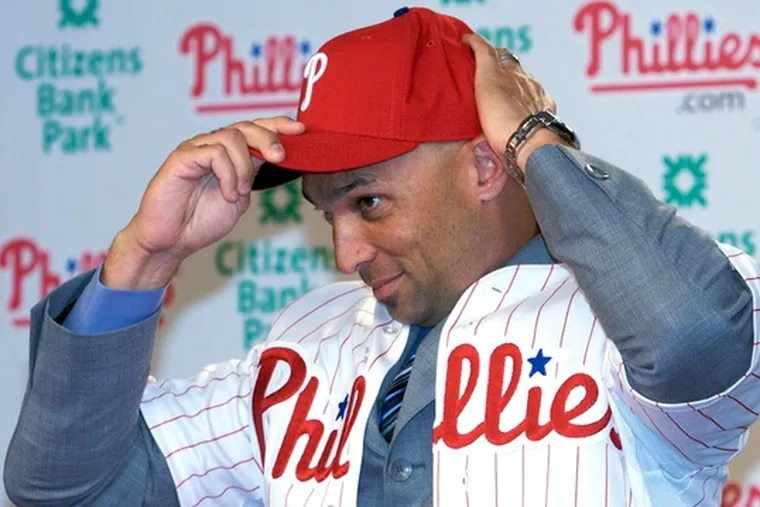 Raul Ibanez' Phillies hat fits as he tries on his new uniform.