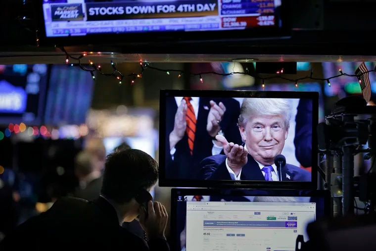 A picture of President Donald Trump is displayed on a computer on the floor of the New York Stock Exchange in New York, Monday, Dec. 24, 2018. (AP Photo/Seth Wenig)