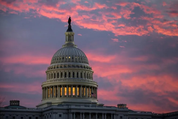 This Thursday, Nov. 30, 2017 file photo shows the U.S. Capitol at dawn in Washington.