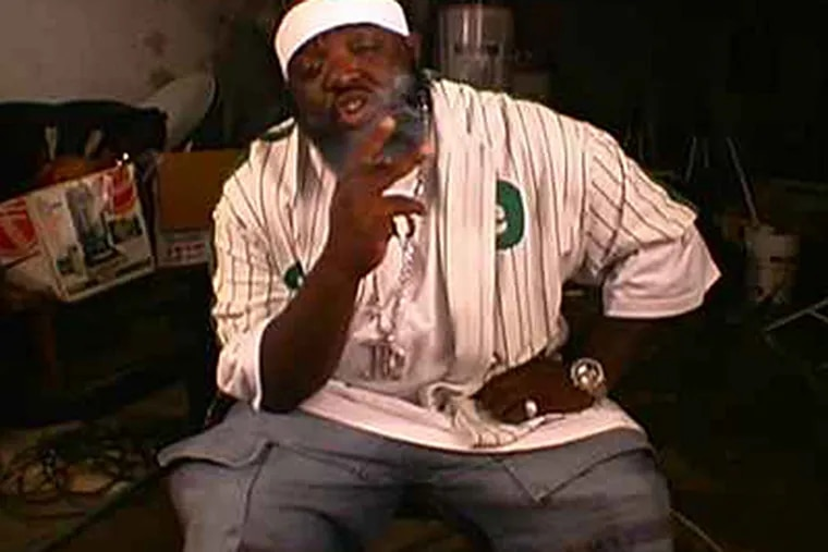 """An indictment alleges that a city police officer tipped off drug kingpin Alton """"Ace Capone"""" Coles (seen here in a still from a rap video), to impending raids of Coles' home and those of his top associates."""