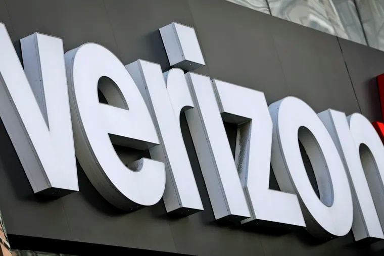 FILE photo shows Verizon corporate signage on a store in New York's Midtown.
