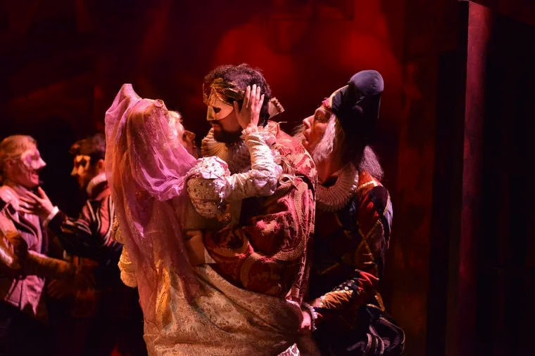The Countess Ceprano (Alejandra Gomez) in the arms of the Duke of Mantua (Marco Cammarota) with Rigoletto (Jared Bybee) behind him in Academy of Vocal Arts' production of Verdi's Rigoletto Credit: AVA/Paul Sirochman.