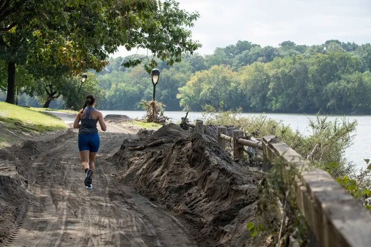 Piles of sand and debris surround the Schuylkill River Trail near the Columbia Train Bridge in Philadelphia, Pa. on Wednesday, September 8, 2021. The remnants of Hurricane Ida caused significant flooding along the popular running and biking trail.