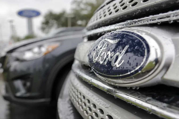 Ford vehicles sit on a Florida dealership lot.