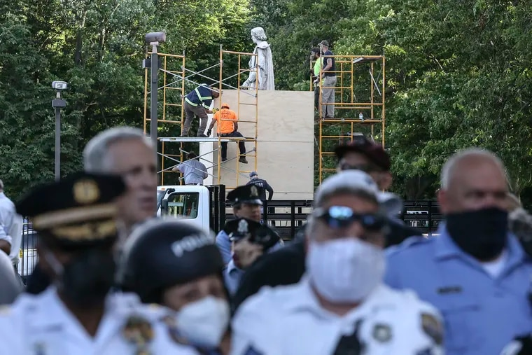 """Police keeps the pro-statue supporters and anti-statue protesters away from each other as the city installs """"a boxing apparatus"""" around the Columbus statue to protect it until the Art Commission initiates a public process, """"for the possible removal."""" at Marconi Plaza in South Philadelphia, Tuesday,  June 16, 2020"""