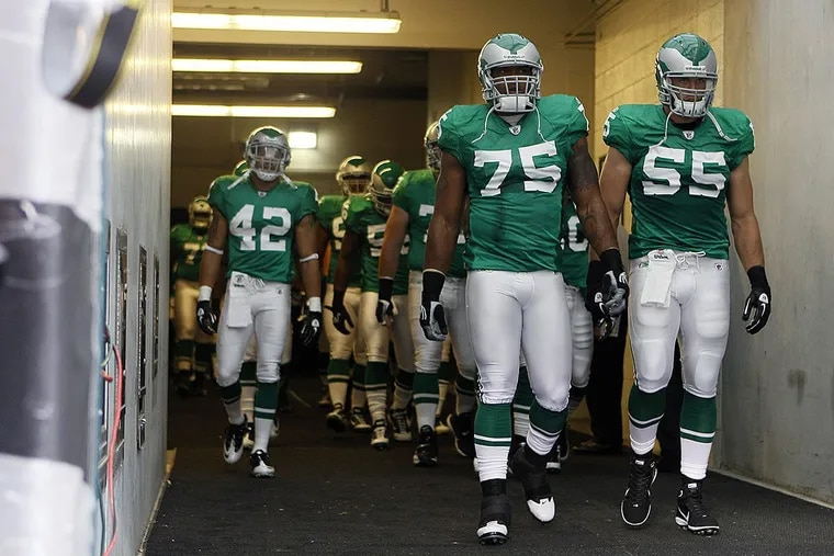 Philadelphia Eagles players walk onto the field before an NFL football game against the Green Bay Packers, Sunday, Sept. 12, 2010, in Philadelphia.
