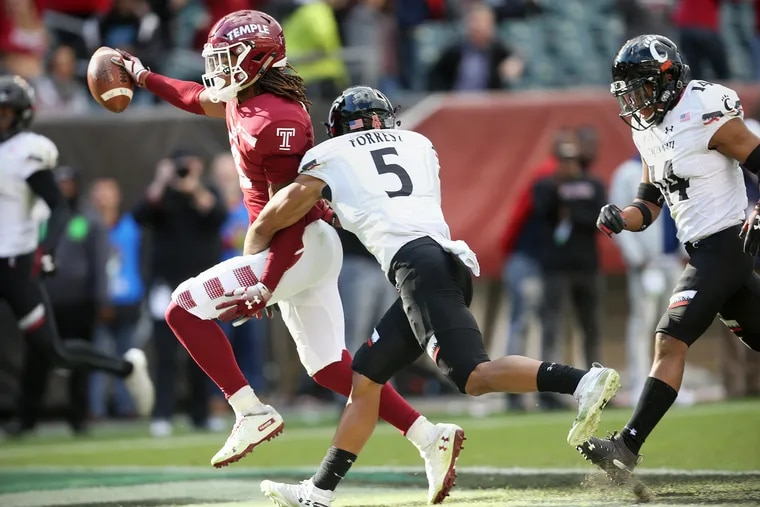 Temple wide receiver Isaiah Wright (13) scores the winning touchdown in overtime past Cincinnati safety Darrick Forrest (5) during a game at Lincoln Financial Field in South Philadelphia on Saturday, Oct. 20, 2018. Temple won 24-17.