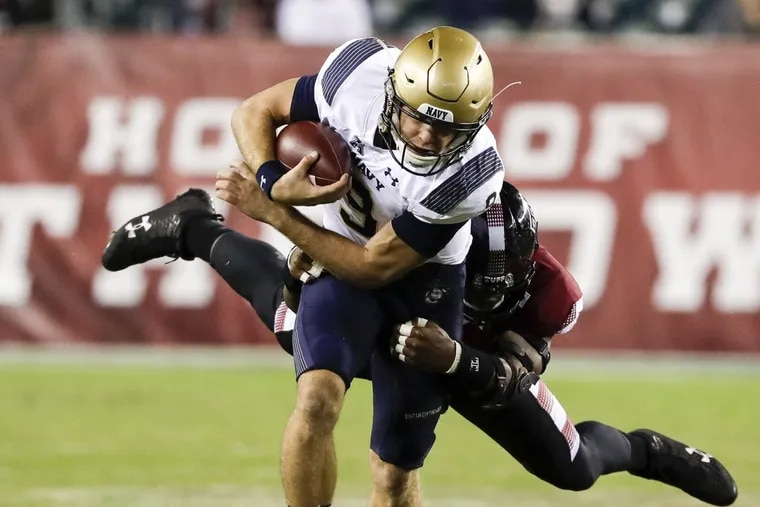 Navy quarterback Zach Abey in action against Temple. The Midshipmen suffered a rare loss to Army last year.