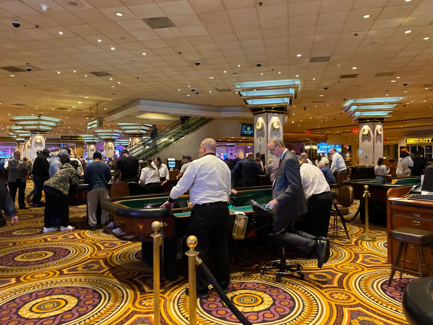 People on the casino floor at Caesar's in Atlantic City, which remained open on Sunday.