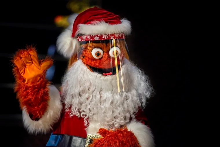 """Gritty Claus appears during a media preview Nov. 24, 2020, for the Wells Fargo Center's new """"Winter on Broad Street Spectacular"""" which will run from Nov. 27 through Jan. 3. The socially-distanced, timed, and masked event will feature 193 light sculptures and displays powered by more than a half-million light bulbs; food & beverage options; a craft market, curling, and photos with the Orange Kris Kringle (for an extra $15 for up to six people)."""