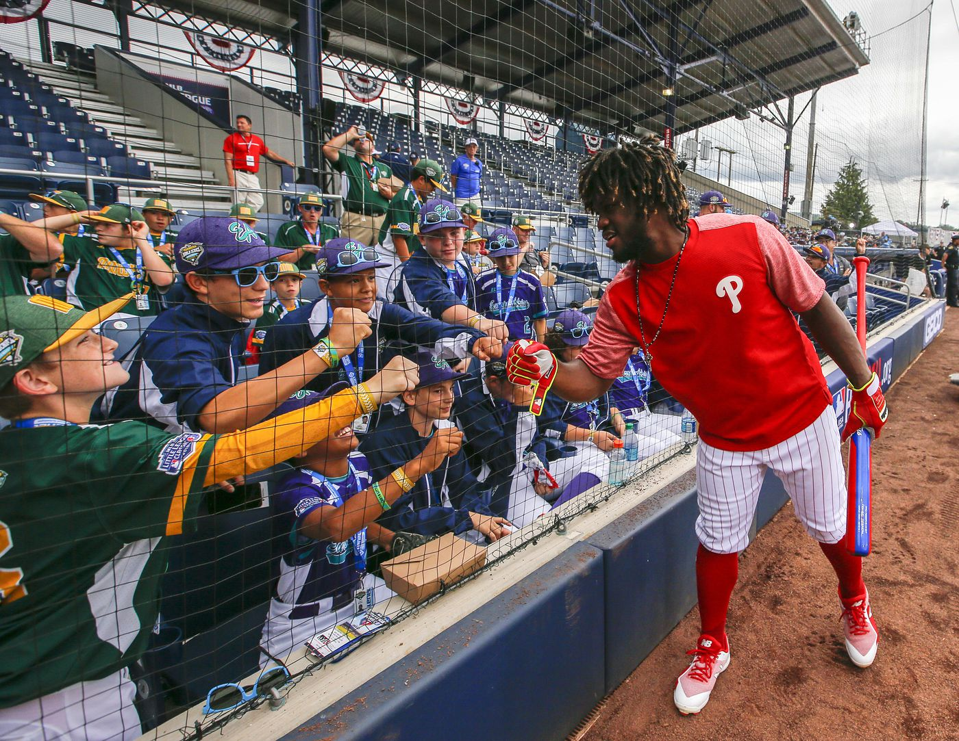 704683057 Odubel Herrera hands out some fist-bumps to Little Leaguers ahead of  Sunday s Mets-