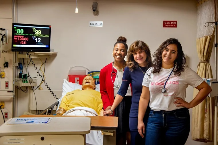Nursing students Jasmine Jones (left) and Genesis Sanchez (right) with Laura Gitlin, dean of the Drexel University College of Nursing and Health Professions in a clinical simulation room at the school. The college has the largest bachelor program in the three-state region.