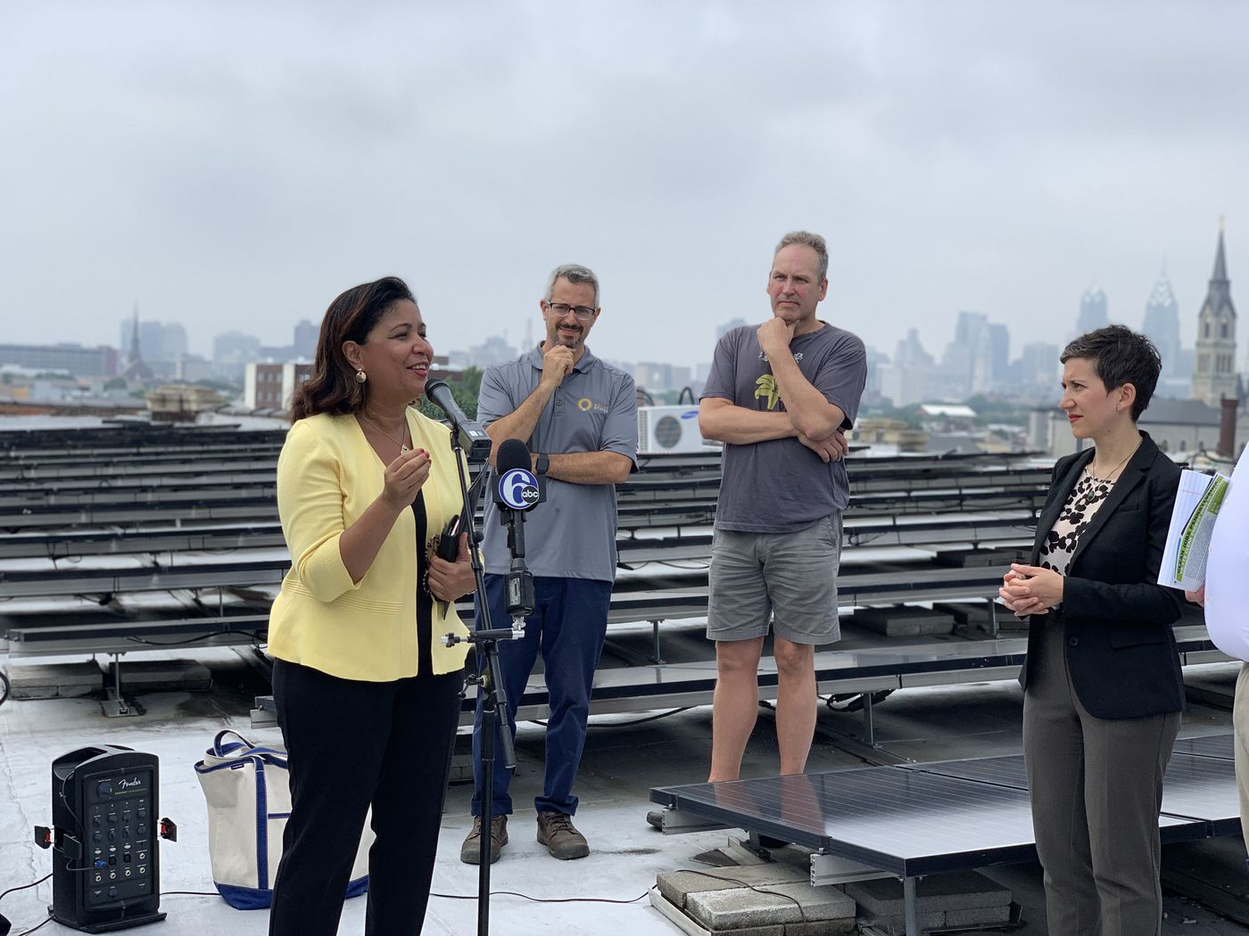 Councilwoman Maria Quiñones-Sanchez gathered with clean energy officials on the top of the Crane Arts Building, which has its roof covered in solar panels, to discuss the recent report detailing Pennsylvania's clean energy job growth, on Tuesday, June 18.