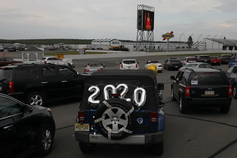 Balloons adorn a senior's car on the track during Jim Thorpe Area High School's graduation at Pocono Raceway in Long Pond, Pa., on Thursday, June 4, 2020. The racetrack is hosting several socially distanced Pennsylvania high school graduations due to the coronavirus pandemic.