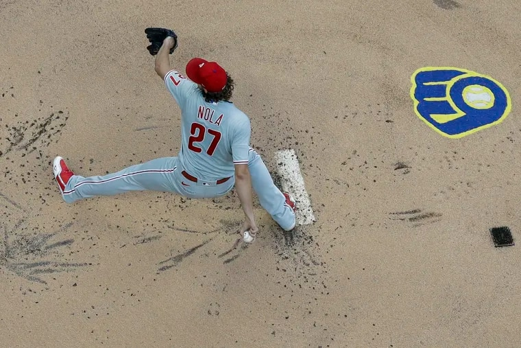 Phillies starter Aaron Nola pitches during the first inning against the Brewers  in Milwaukee.