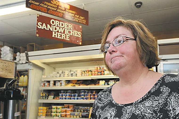 In Haddon Heights, folks at John's Friendly Market are mourning owner John Johnson. Here, longtime customer Cathy Chando talks about what John and the Market have meant to her. (April Saul / Staff Photographer)