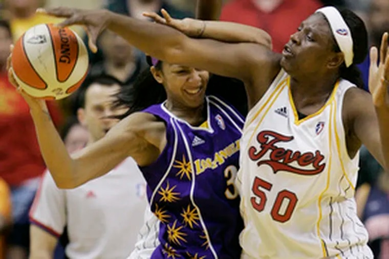 Los Angeles' Candace Parker (left) battles Indiana's Bernadette Ngoyisa. Parker, a rookie, says freedom is the biggest difference between college and the pros.