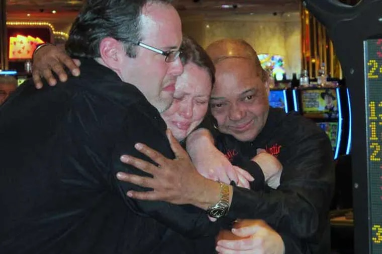 Dealers at the Atlantic Club share a tearful hug just after the Atlantic City casino shut its doors early Monday. The casino hotel was sold at a bankruptcy auction in December to two competitors, who will strip it for parts. (Wayne Parry / Associated Press)