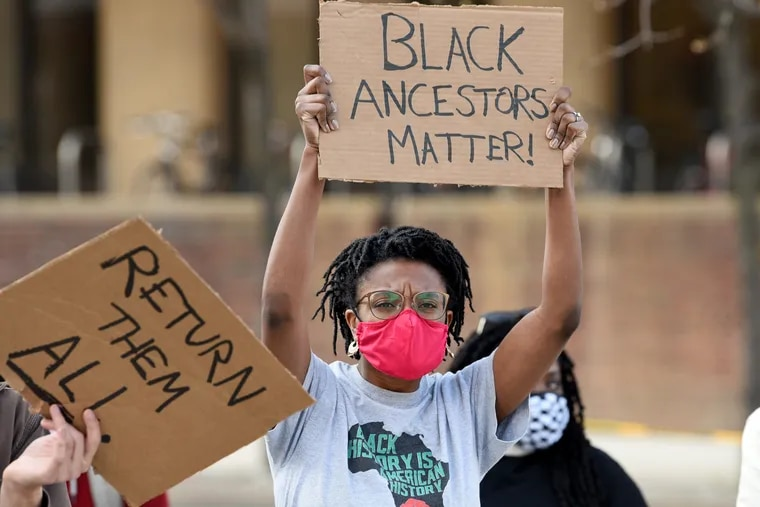 VanJessica Gladney, a University of Pennsylvania grad student with the Penn & Slavery Project attends a rally Thursday organized by Police Free Penn demanding that the Penn Museum repatriate skulls held by the Morton skull collection.