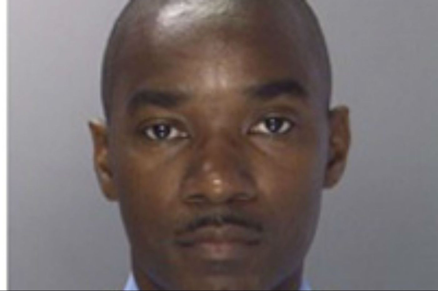 Judge clears fired Philly officer in domestic-abuse case