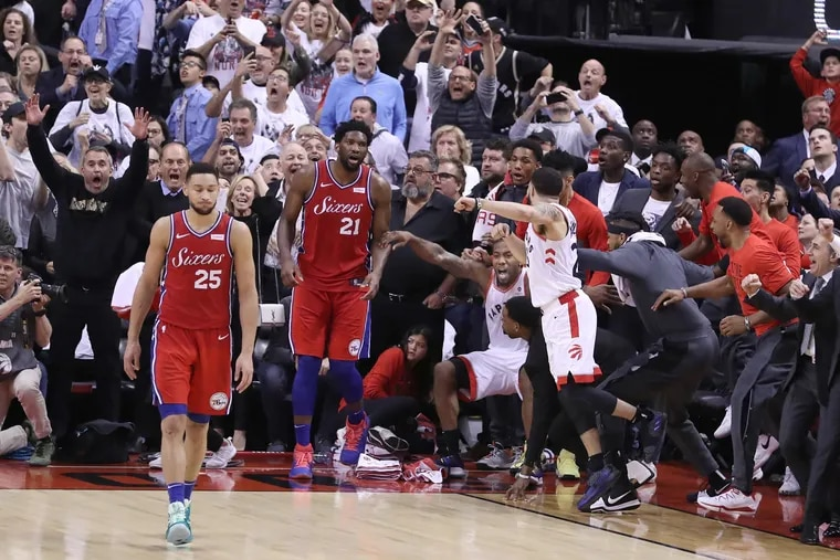The now-famous buzzer-beater by the Raptors' Kawhi Leonard (center) to beat the Sixers in the Eastern Conference semifinals was arguably the most memorable, and painful, moment of the year in Philadelphia sports.