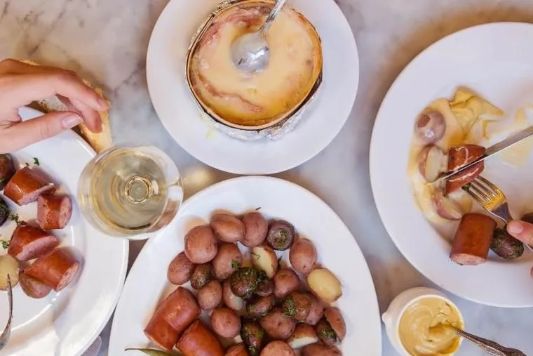 A molten wheel of Mont d'Or cheese is the centerpiece of a Juras-style feast at Bistrot la Minette, where it's available by special order throughout the month of November.