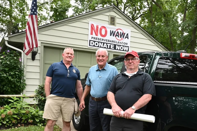 """Cherry Hill residents (from left) Steve Walsh, Wes Hughes, and Bruce Sizer in front of Hughes' garage in the Barclay Farms neighborhood near the site of the proposed """"super"""" Wawa."""