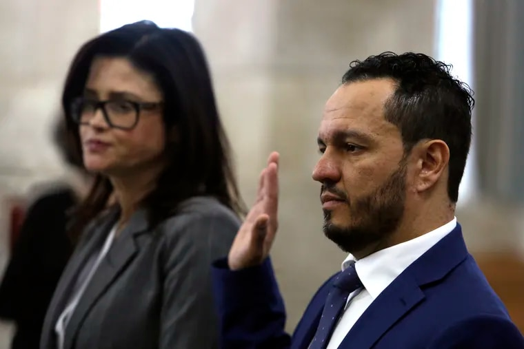 Albert Alvarez takes the oath before testifying at the joint legislative oversight committee, Tuesday March 12, 2019 in Trenton, NJ. Alvarez, a former Murphy administration official accused of sexual assault but not criminally charged discussed the administration's hiring practices during the hearing. A key unanswered question after months of legislative hearings is who hired Alvarez at the schools authority.
