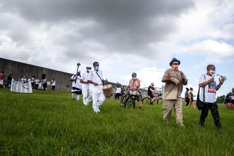 A march and secondline starts on the levee after the Hurricane Katrina 15th Anniversary Healing Ceremony in the Lower 9th Ward in New Orleans, Saturday, Aug. 29, 2020.