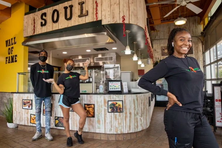 Sharonda Harris-Bunton, at her second Vegans Are Us restaurant in Atlantic City's Tanger Outlets. In the background are employees Tariq Elam and Kyra Smiley.
