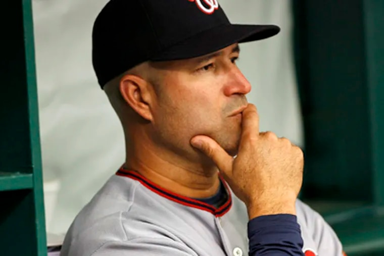 Some managers such as Manny Acta of the Washington Nationals could be replaced soon.   (AP Photo/Brian Blanco)