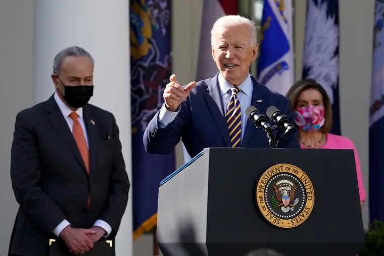 President Joe Biden in the Rose Garden of the White House on Friday with Senate Majority Leader Chuck Schumer, left, and House Speaker Nancy Pelosi.