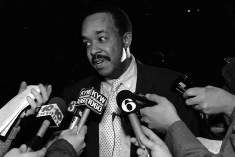 Robert Ross, then Philadelphia's deputy health commissioner, talks to the media on Feb. 17, 1991. When he asked a North Philadelphia pastor to immunize all children in his congregation, the request was refused. (File photo)