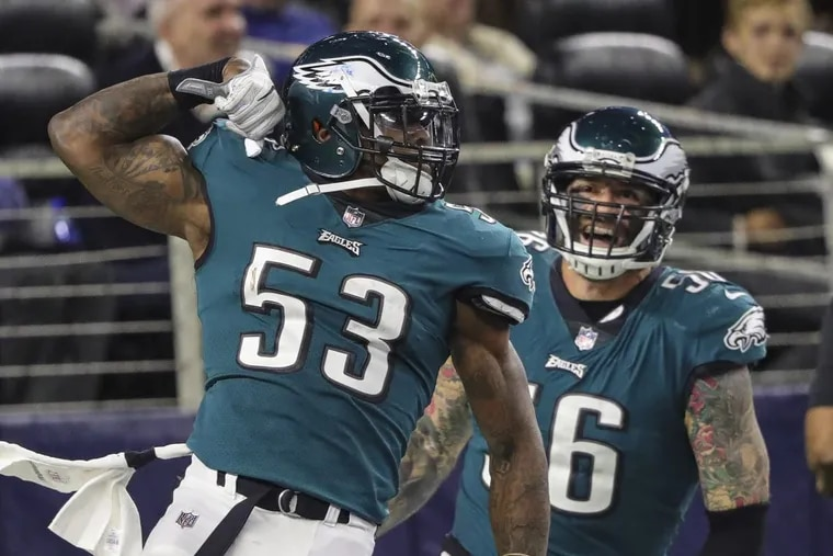 Eagles defensive linebacker Nigel Bradham celebrates his 4th quarter fumble return for a touchdown during the game in Dallas November 19, 2017. Defensive end Chris Long comes up to celebrate with Bradham. DAVE MAIALETTI / Staff Photographer