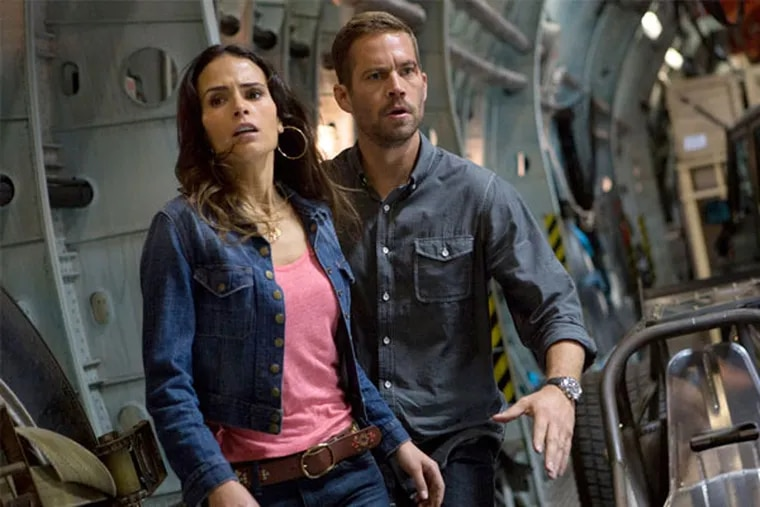 """This film publicity image released by Universal Pictures shows Jordana Brewster, left, and Paul Walker in a scene from """"Fast & Furious 6."""" (AP Photo/Universal Pictures, Giles Keyte)"""