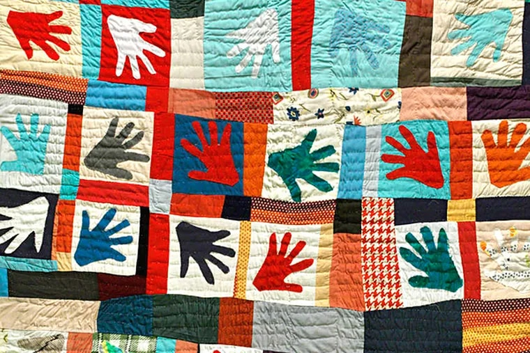 """""""Hands"""" quilt (Winter 1980), by Sarah Mary Taylor, from the Ella King Torrey Collection of African American Quilts, in a 2008-09 Art Museum exhibit."""