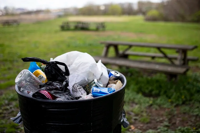 A garbage can full of trash at Bartram's Garden on Wednesday, April 8, 2020. The coronavirus has shut down hundreds of cleanups and leaving parks and waterways filthy.