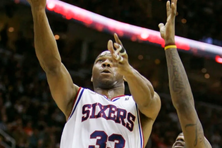 The 76ers' Willie Green shoots against the Cavaliers' LeBron James. Green led the Sixers in scoring with 19 points.